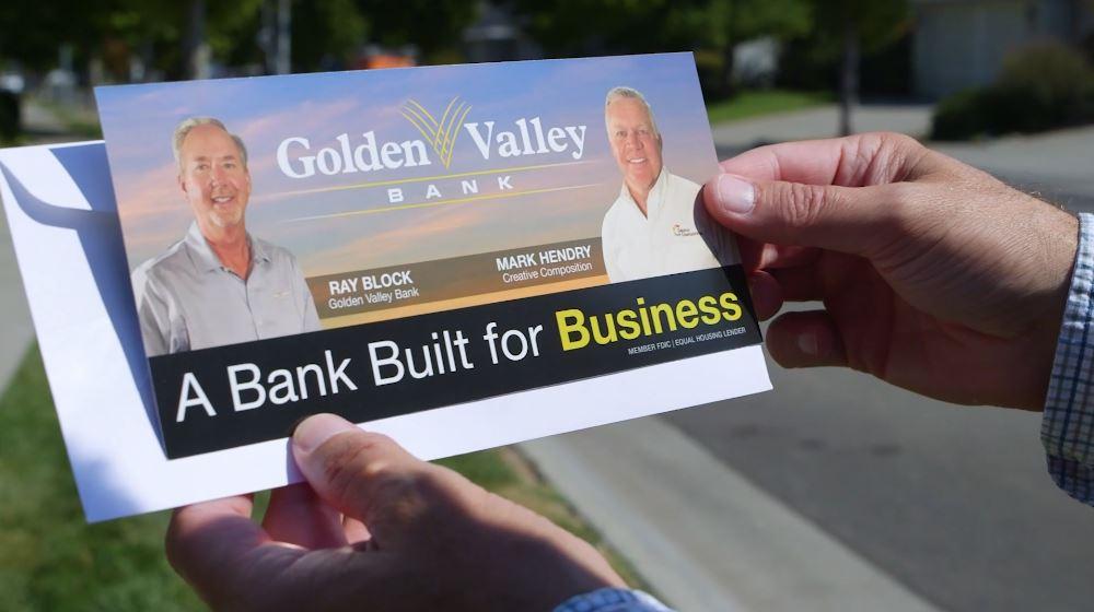 Hands holding Golden Valley Bank Flyer